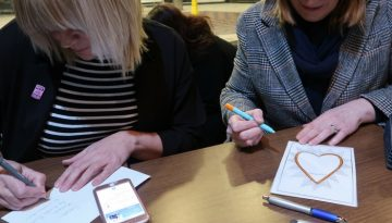 Photo of ladies writing Feel Good cards