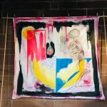 Hand painted on a square piece of material. Image is a skeleton and has splashes of colour