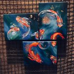 3 separate canvas joined together. Each canvas has a hand painted koi carp fish. There are flecks of gold running through the water