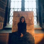 hand painted female portrait placed in front of the window at St Mary's Guildhall